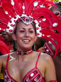 Girl in red feathers at Notting Hill Carnival